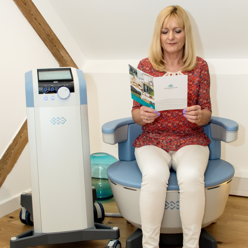 Clients can relax and read during the EMSELLA treatment